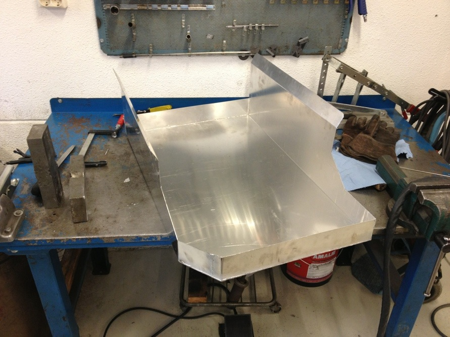 Construction Belly Pan : Oil pan mounted on car and new belly fabricated